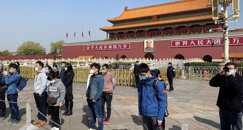 La pausa de tres minutos en toda China ocurrió a las 10:00 a.m. del sábado 4 de abril . (Foto: AFP/Leo Ramírez)