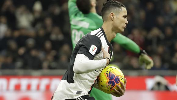 Juventus' Cristiano Ronaldo celebrates after scoring his side's opening goal from the penalty spot during an Italian Cup soccer match between AC Milan and Juventus at the San Siro stadium, in Milan, Italy, Thursday, Feb. 13, 2020. (AP Photo/Luca Bruno)
