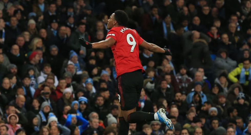 Manchester United's French striker Anthony Martial celebrates scoring their second goal during the English Premier League football match between Manchester City and Manchester United at the Etihad Stadium in Manchester, north west England, on December 7, 2019. (Photo by Lindsey Parnaby / AFP) / RESTRICTED TO EDITORIAL USE. No use with unauthorized audio, video, data, fixture lists, club/league logos or 'live' services. Online in-match use limited to 120 images. An additional 40 images may be used in extra time. No video emulation. Social media in-match use limited to 120 images. An additional 40 images may be used in extra time. No use in betting publications, games or single club/league/player publications. /