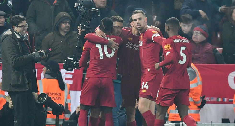 Liverpool's Brazilian midfielder Roberto Firmino (2L) celebrates scoring before the goal is disallowed after VAR review for a foul in the build up during the English Premier League football match between Liverpool and Manchester United at Anfield stadium in Liverpool, north west England on January 19, 2020.  - RESTRICTED TO EDITORIAL USE. No use with unauthorized audio, video, data, fixture lists, club/league logos or 'live' services. Online in-match use limited to 120 images. An additional 40 images may be used in extra time. No video emulation. Social media in-match use limited to 120 images. An additional 40 images may be used in extra time. No use in betting publications, games or single club/league/player publications.  / AFP / Paul ELLIS / RESTRICTED TO EDITORIAL USE. No use with unauthorized audio, video, data, fixture lists, club/league logos or 'live' services. Online in-match use limited to 120 images. An additional 40 images may be used in extra time. No video emulation. Social media in-match use limited to 120 images. An additional 40 images may be used in extra time. No use in betting publications, games or single club/league/player publications.