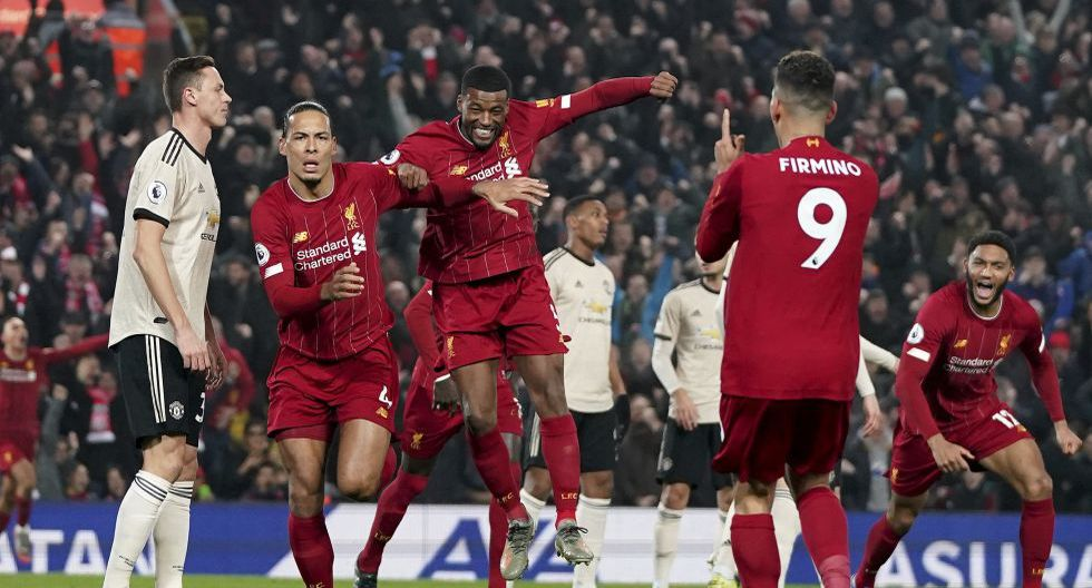 Liverpool's Virgil van Dijk, second from left, celebrates scoring his side's first goal during the English Premier League soccer match between Liverpool and Manchester United at Anfield Stadium in Liverpool, Sunday, Jan. 19, 2020.(AP Photo/Jon Super)