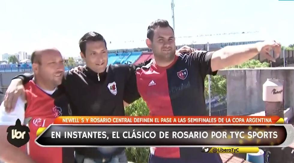 Dos hinchas de Newell's Old BOys y uno de Rosario Central se juntaron en un techo para ver el clásico. (TyC Sports)