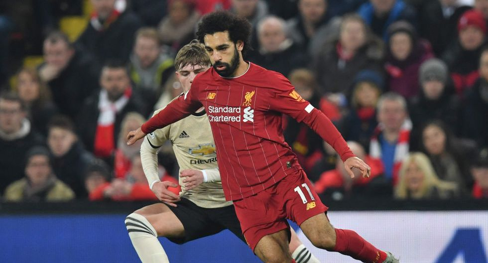 Liverpool's Egyptian midfielder Mohamed Salah (R) takes on Manchester United's English defender Brandon Williams (L) during the English Premier League football match between Liverpool and Manchester United at Anfield stadium in Liverpool, north west England on January 19, 2020.  - RESTRICTED TO EDITORIAL USE. No use with unauthorized audio, video, data, fixture lists, club/league logos or 'live' services. Online in-match use limited to 120 images. An additional 40 images may be used in extra time. No video emulation. Social media in-match use limited to 120 images. An additional 40 images may be used in extra time. No use in betting publications, games or single club/league/player publications.  / AFP / Paul ELLIS / RESTRICTED TO EDITORIAL USE. No use with unauthorized audio, video, data, fixture lists, club/league logos or 'live' services. Online in-match use limited to 120 images. An additional 40 images may be used in extra time. No video emulation. Social media in-match use limited to 120 images. An additional 40 images may be used in extra time. No use in betting publications, games or single club/league/player publications.