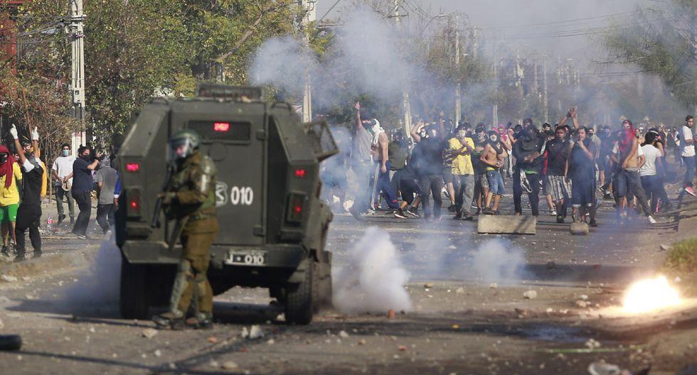 Reportan violentos disturbios al sur de Santiago de Chile por falta de alimentos. (Foto referencial: AFP/Pablo Rojas)
