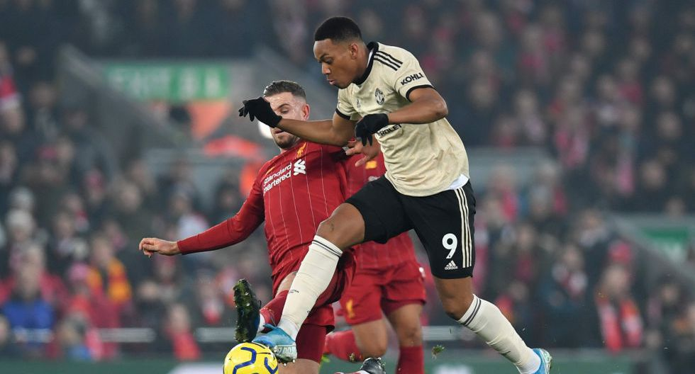 Manchester United's French striker Anthony Martial (R) takes on Liverpool's English midfielder Jordan Henderson (L) during the English Premier League football match between Liverpool and Manchester United at Anfield stadium in Liverpool, north west England on January 19, 2020.  - RESTRICTED TO EDITORIAL USE. No use with unauthorized audio, video, data, fixture lists, club/league logos or 'live' services. Online in-match use limited to 120 images. An additional 40 images may be used in extra time. No video emulation. Social media in-match use limited to 120 images. An additional 40 images may be used in extra time. No use in betting publications, games or single club/league/player publications.  / AFP / Paul ELLIS / RESTRICTED TO EDITORIAL USE. No use with unauthorized audio, video, data, fixture lists, club/league logos or 'live' services. Online in-match use limited to 120 images. An additional 40 images may be used in extra time. No video emulation. Social media in-match use limited to 120 images. An additional 40 images may be used in extra time. No use in betting publications, games or single club/league/player publications.